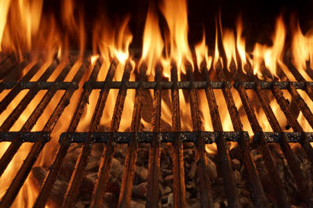 Empty Barbecue Charcoal Cast Iron Grill Close-up With Bright Flames Isolated On Black Background.