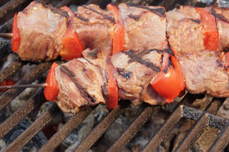 kebob: BBQ Beef Kebabs Mixed With Vegetables On The Hot Charcoal Grill Background Close-up