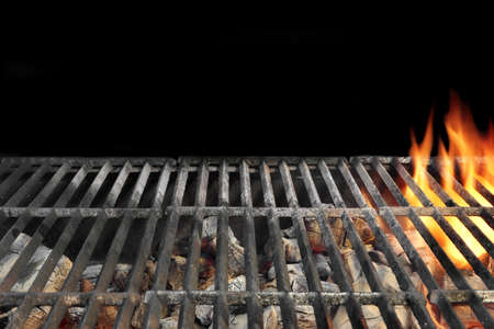 Close-up Of Flaming BBQ Charcoal Grill Isolated On Black Background