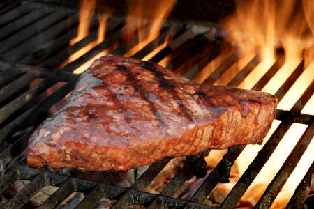 Beef Steak On The BBQ Flaming Charcoal Grill Close-up Stock Photo
