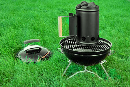 briquettes: BBQ Kettle Portable Grill Appliance With Charcoal Briquettes Starter On The Summer Lawn, Picnic Or Cookout Concept