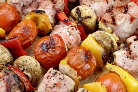 cooked pepper ball: BBQ Grilled Mixed With Vegetables Pork Kebabs On The Wooden Cutting Board Stock Photo