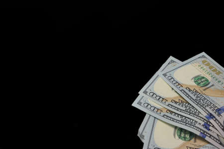 high angle view: Five Hundred USA Dollar Bills Isolated In Right Corner Of Black Background High Angle View Close-up Stock Photo