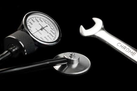 sphygmomanometer: Manual Sphygmomanometer Isolated On Black Background Close-up Stock Photo