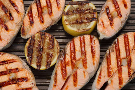 cast iron pan: Grilled Salmon Slice And Lemon On The Cast Iron Pan