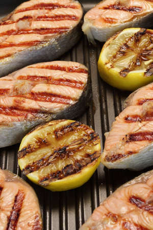seared: Grilled Salmon Steaks And Lemon On The Cast Iron Pan Stock Photo
