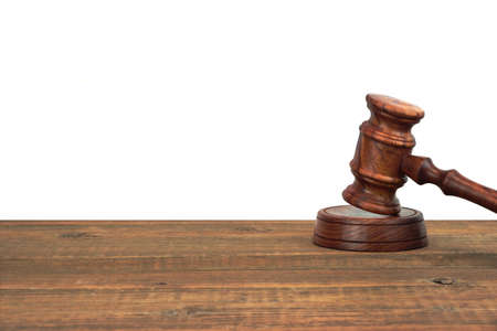 judicial: Judges Or Auctioneers Wood Rough Desk With Gavel On The Sound Board Isolated On White Background With Copy Space. Judicial System Concept Stock Photo