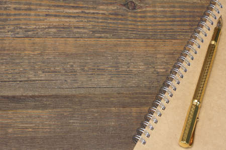 memoir: Notepad With Real 24k Gold Fountain Pen On The Old Rough Wooden Table Background Stock Photo