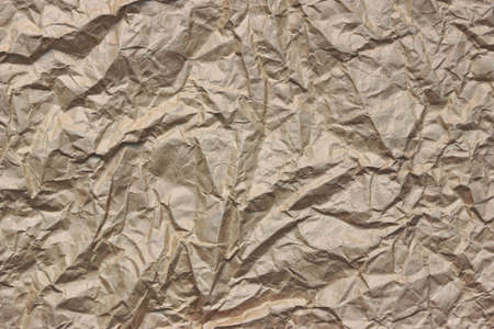 scabrous: Close-up Of Rough Brown Wrinkled Packaging Paper Texture Background With Copy Spce For Text Or Image Stock Photo