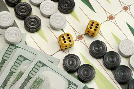 doubling: Backgammon Cardboard Playing Area, Wood Chips, Money And Two Dices With Win Double Six Points