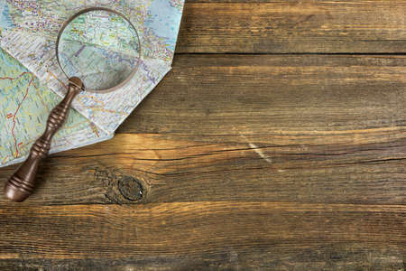 old desk: Eastern Europe Modern Road Map And Magnifier On The  Rustic Rough Brown Wood Table, Concept For Travel Or Asylum Stock Photo