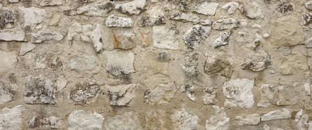 stonework: Ancient Granite Stone Wall With Cement Seam, Stonework Wide Background Texture Close-up