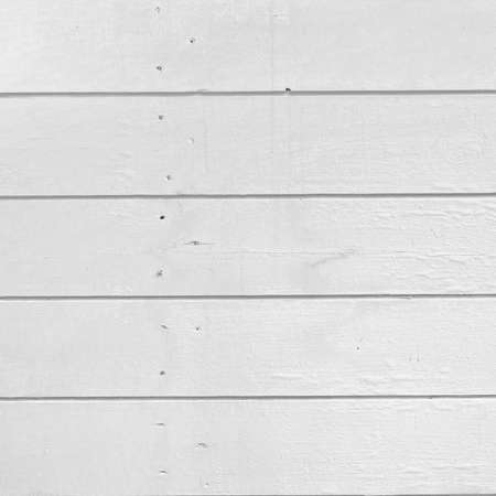 isolated on white: Old Weathered Rough Rustic Painted White Wall With Nails Texture And Background With Space For Text Or Image Stock Photo
