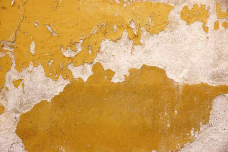 discolorations: Old White Concrete Wall With Peeled Yellow Paint, Abstract Background Texture Stock Photo