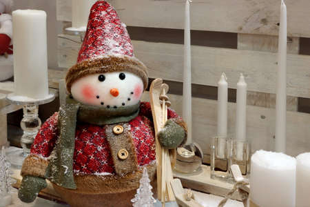 snowman wood: Christmas Decorative Composition With Snowman And Candles On The White Wood Background
