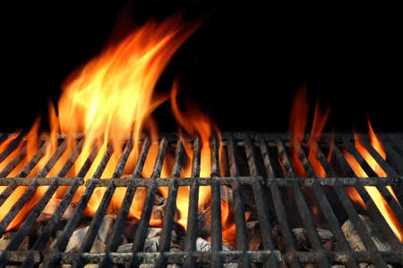 cook out: Hot Barbecue Charcoal Grill With Bright Flames Isolated On Black Background