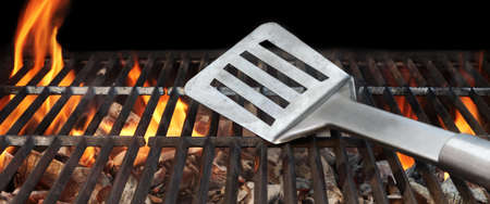 BBQ Grill And Spatula. Flame Of Fire In The Background. Stock Photo
