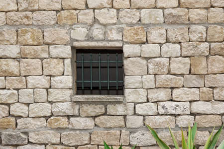 lattice window: Old White Stonewall With Lattice Window Background Texture Stock Photo