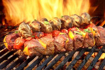 kebab: Spit Roast Beef Kebabs On The Hot Flaming BBQ Grill Close-up