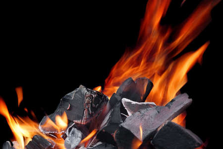 holzbriketts: Hot Glowing Charcoal With Bright Flames Isolated On The Black Background Closeup Lizenzfreie Bilder