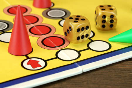 ludo: ludo Or  Parchis Game Board With Red Playing Figures And Two Gold Color Dices With Double Six Points