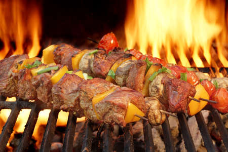 barbecue fire: Spit Roast Beef Kebabs On The Hot Flaming BBQ Grill Close-up