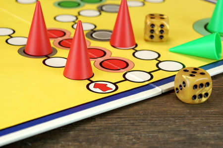 double game: ludo Or  Parchis Game Board With Red Playing Figures And Two Gold Color Dices With Double Six Points