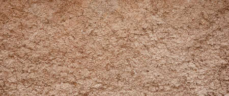 Decorative Brown Colored Grained Cement Plaster Wall Wide Background Texture Close Up Stock Photo