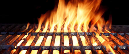 Close-up Of Hot BBQ Flaming Grill With Bright Flames And Glowing Coals