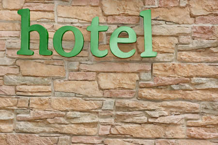 occupancy: Hotel Sign On Artificial Stone Wall Background. Vacation Concept Stock Photo