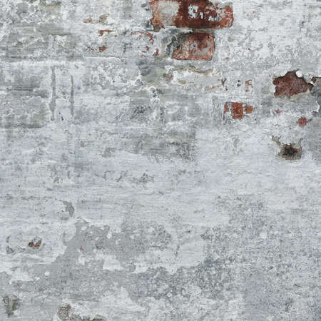 uneven edge: Red Brick Wall With Damaged White Plaster Background Texture Close-up Foto de archivo