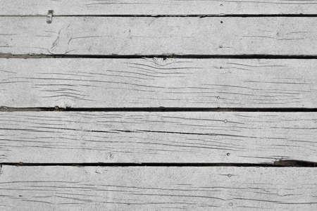 wood flooring: Shabby Cracked White Wood Beach Bar Patio Flooring Background Texture Stock Photo