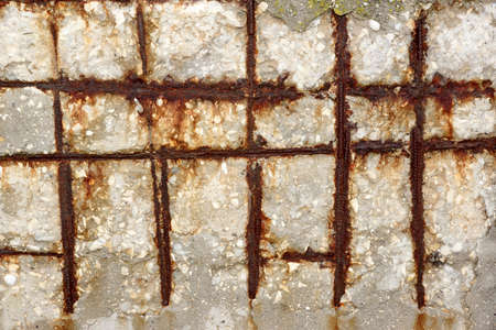 rusty wire: Fragment of a concrete wall with a rusty wire mesh background texture Stock Photo