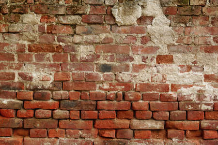 uneven: Old Uneven  Crumbling Red Brick Wall Background Texture