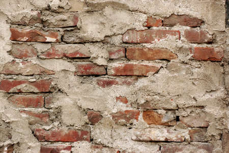 crumbling: Old Uneven  Crumbling Red Brick Wall Background Texture