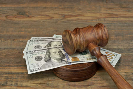 penalty: Concept For Corruption, Bankruptcy Court, Bail, Crime, Bribing, Fraud, Auction Bidding. Judges or Auctioneer Gavel, Soundboard And Bundle Of Dollar Cash On The Rough Wooden Textured Table Background.