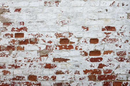 Red Brick Wall With Damaged White Plaster Background Texture Close-up Stock Photo