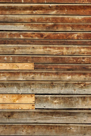 vandal: Weathered Old Natural Wood Siding Panel With Hanwritten Vandal Signs Background Texture Stock Photo