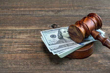 unfairness: Judges or Auctioneer Gavel, Soundboard And Bundle Of Dollar Cash On The Rough Wooden Table. Idea For Corruption, Bankruptcy Court, Bail, Business And Financial Crime, Bribing, Fraud, Auction Bidding