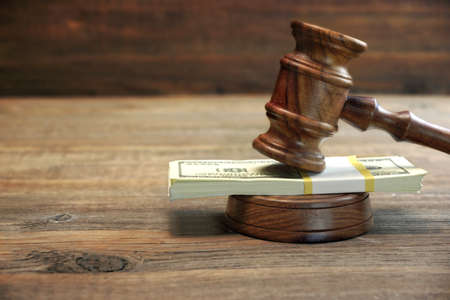 Judges or Auctioneer Gavel, Soundboard And Bundle Of Dollar Cash On The Rough Wooden Table. Idea For Corruption, Bankruptcy Court, Bail, Business And Financial Crime, Bribing, Fraud, Auction Bidding
