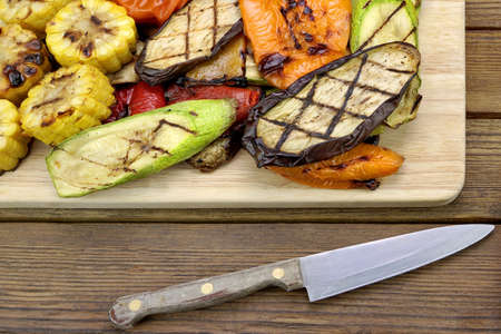 cook out: Healthy Grilled Food. Hot BBQ Sliced Vegetables  Assortment On The Cutting Board.
