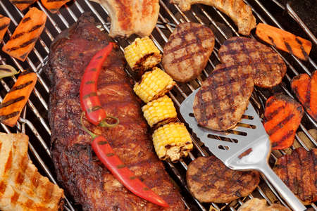 barbecue grill: BBQ Spareribs, Steaks, Hamburger Patties, Corn And Pepper On The Hot Charcoal Grill. Cookout Food For Summer Weekend Picnic, Outdoor Dinning Or Party.