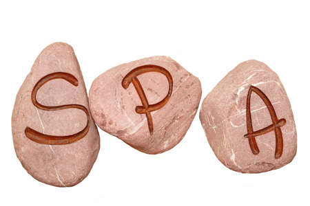 advertising signs: SPA Sign Engraved On The Stones Isolated On White Background, Health Treatments Or  Balneotherapy Concept And Idea