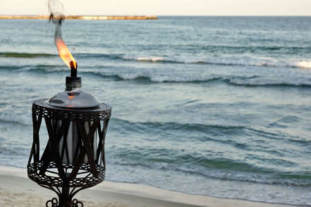 oil lamp: Outdoor Oil Lamp Flaming On  The Sea Shore At The Evening