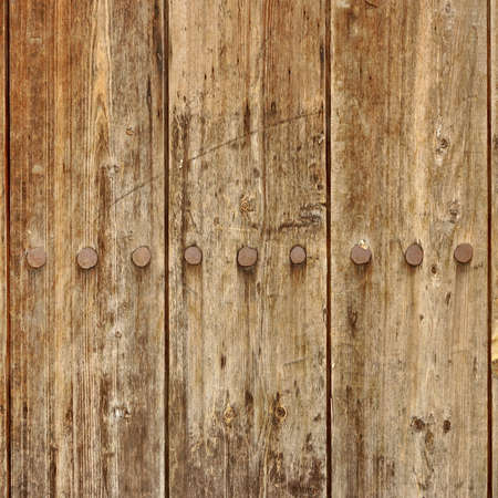 wood backgrounds: Old Brown Wood Plank Panel With Forged Rusty Iron Nails Close-Up Texture Background