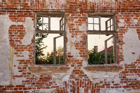Old Peeled Lonely Brick Wall With Two Broken Wood Windows Frame