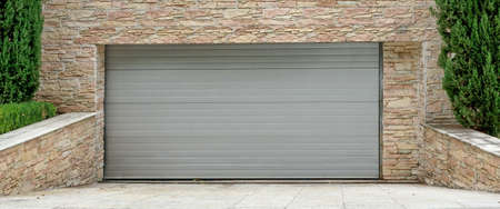 Automatic Electric Roll-up Commercial Garage Gate Or Push-up Door In The Modern Building Ground Floor 스톡 콘텐츠