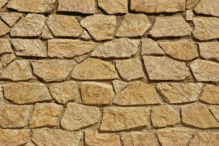 Tiled Stonewall From Flagstone And Limestone Rocks, Background Texture Close-up