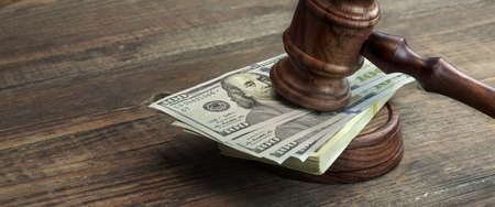 bail: Close-up Of Judges Gavel, Soundboard And Bundle Of Dollar Cash On The Rough Wooden Table. Concept For Corruption, Bankruptcy Court, Bail, Business Or Financial Crime, Bribing, Fraud, Auction Bidding Stock Photo