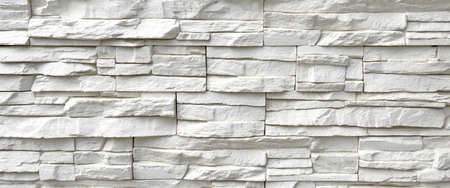 White Artificial Stone Wall. Background and Texture for text or image.